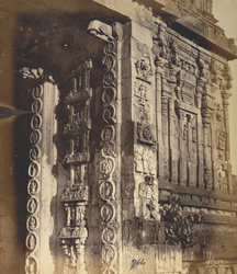 Close view of scrollwork ornamentation and other sculptural detail on the architrave of the entrance gopura of the Narasimha Temple, Ahobilam